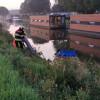 Een gewonde bij voertuig te water Stroobos