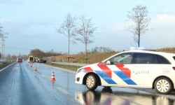 Auto in sloot langs Centrale As door hagelbui