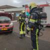 Auto in brand bij tankstation